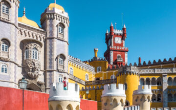 1 Day Sintra Itinerary - view of red and yellow Pena Palace walls and clock tower
