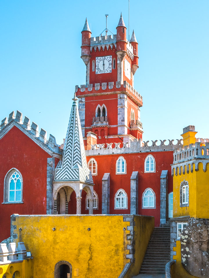 Sintra Pena Palace red clock tower with stairs and yellow walls and