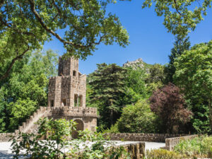 Quinta da Regaleira brick tower with view of Castle of the Moors