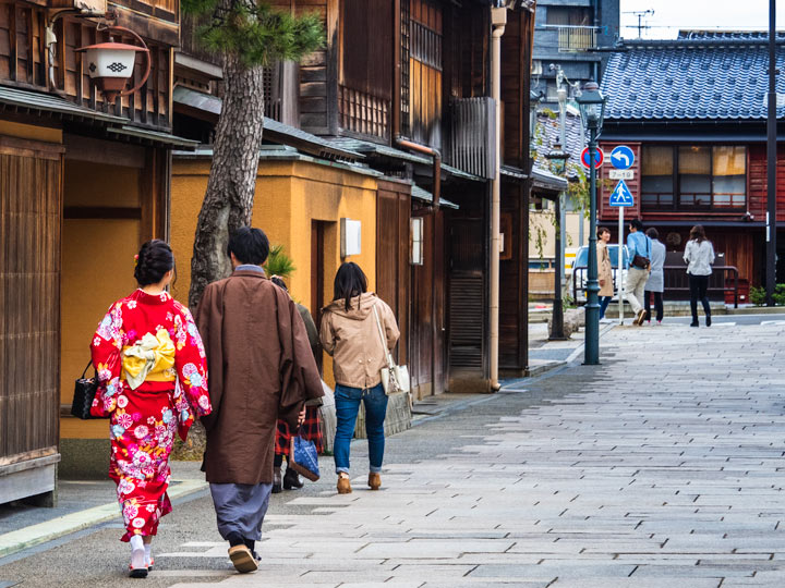 Couple in yukata walking down street in Kanazawa
