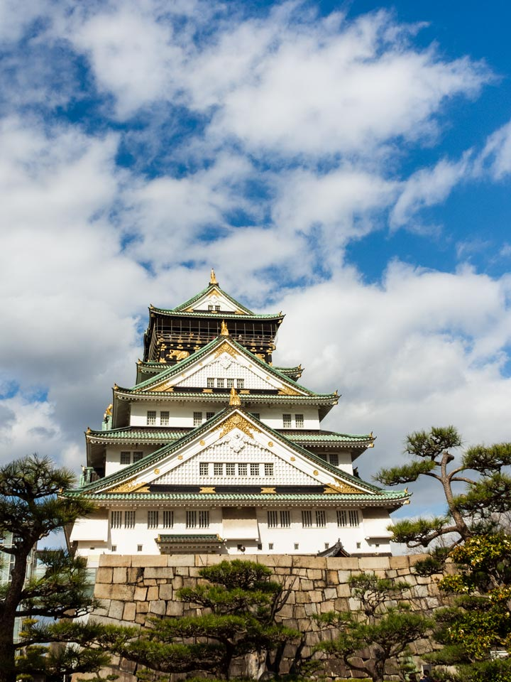 Front of Osaka Castle against partly cloudy sky