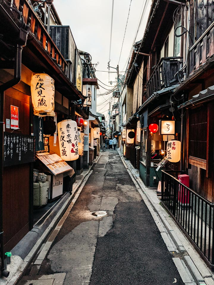 Kyoto Pontocho alley in evening with lanterns and wood facades
