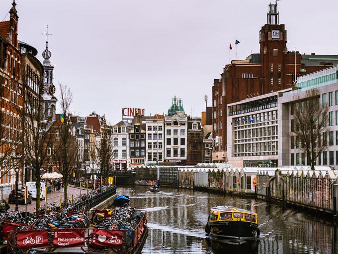 View of Amsterdam Bloemenmarkt with yellow boat