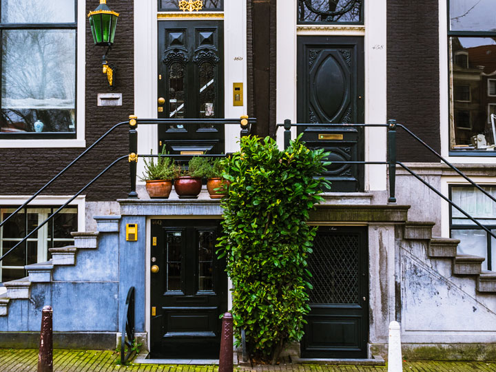 Two house facades with four doors and staircases seen during 2 days in Amsterdam itinerary
