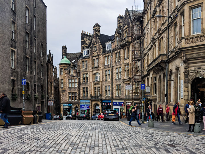 Street view of stone buildings and crosswalk in Edinburgh