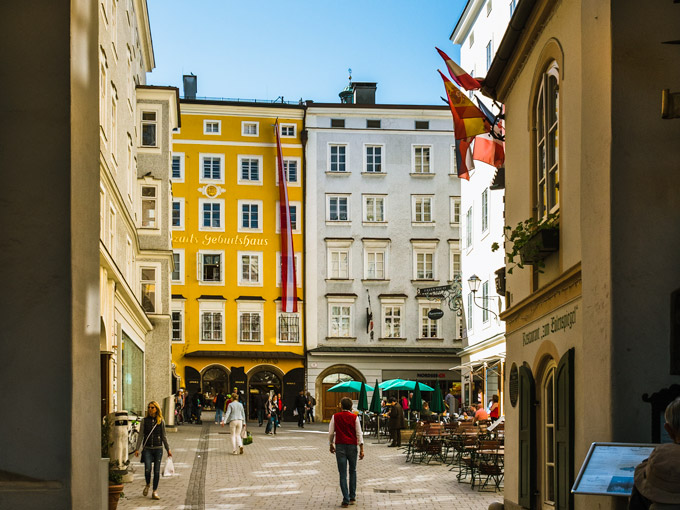 Yellow and white buildings of Mozartplatz, a popular place to visit during 2 days in Salzburg