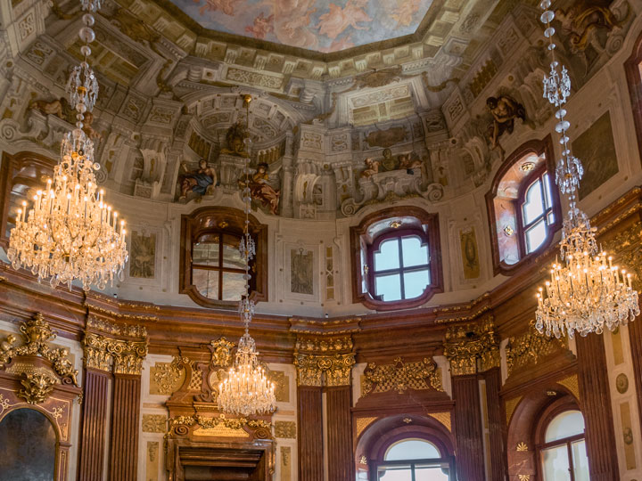 Interior of Schloss Belvedere with three chandeliers and painted mural ceiling