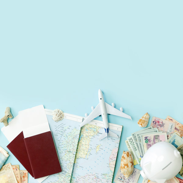 Moving abroad flat lay concept with plane, passport, map, and money