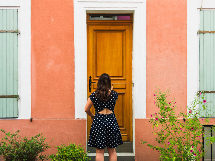 About The Portable Wife - girl in blue and white polka dot dress knocking on door