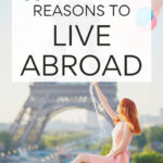11 amazing reasons to live abroad - girl in dress by Eiffel Tower
