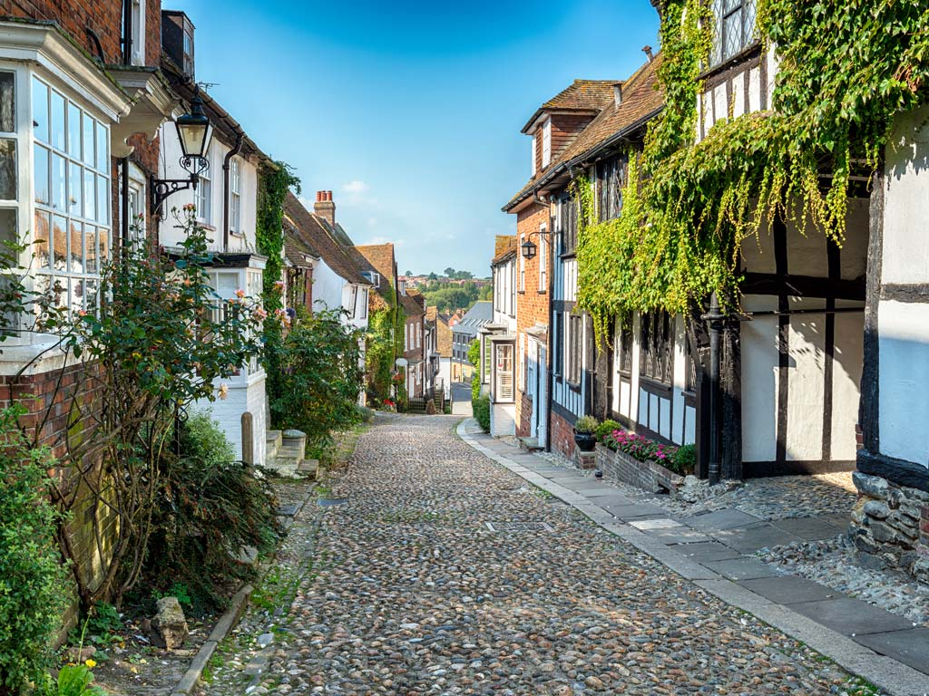 Cobbled street lined with old timbered houses in Rye UK.