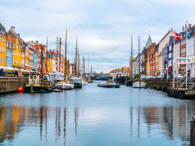 View of Nyhavn Copehagen water port with colorful houses and boats