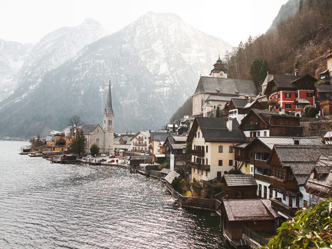 Panoramic view of Hallstatt village with mountains and water reflection, smallest of the best European cities for photography