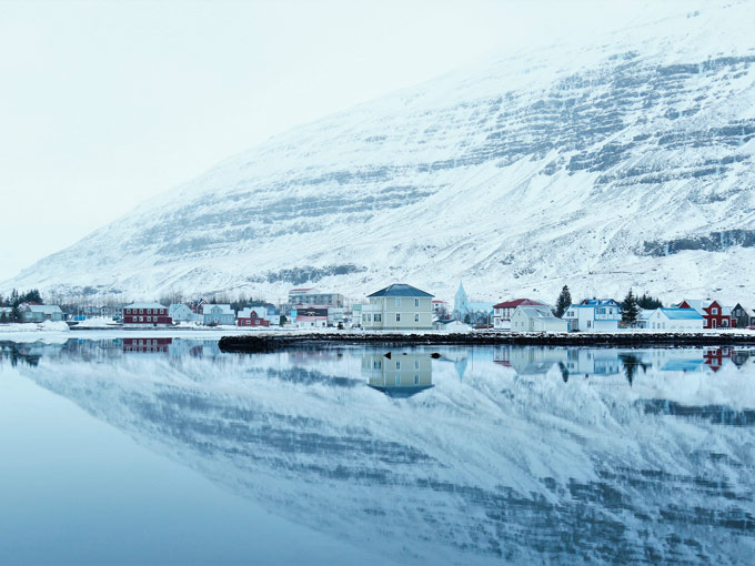 Winter fjord reflection view of village houses of Seydisfjordur Iceland, one of the best European cities for photography