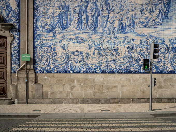 Azulejo blue tile mosaic on wall in Porto, a popular place to take photos in Europe