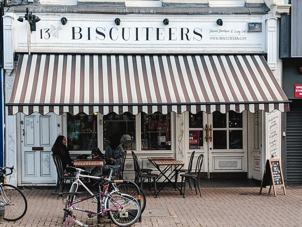 Exterior of Biscuiteers shop in London with black and white striped awning.