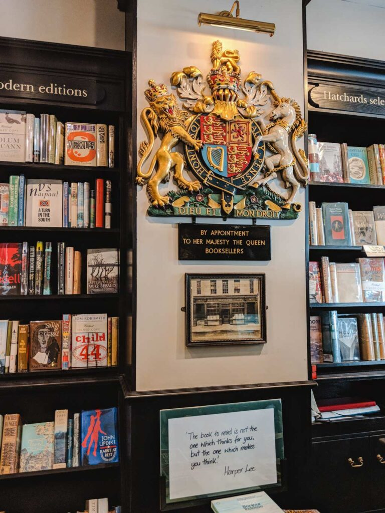 Interior of Hatchards bookshop in London with Royal Warrant seal on wall.