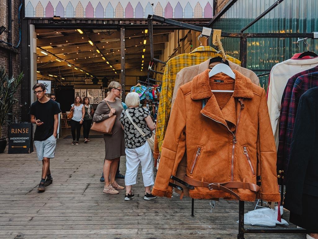Racks of vintage jackets outside Brick Lane Vintage market in London.