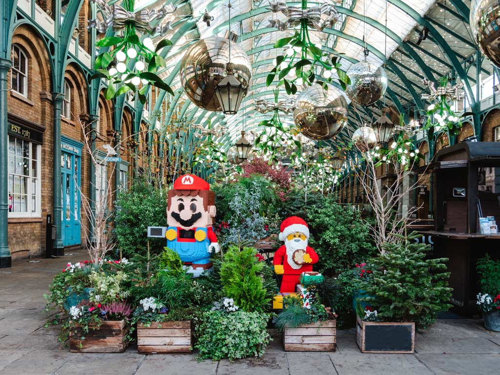 Holiday display with Mario and Santa Claus LEGO figures in Covent Garden, seen while shopping for best gifts from London.