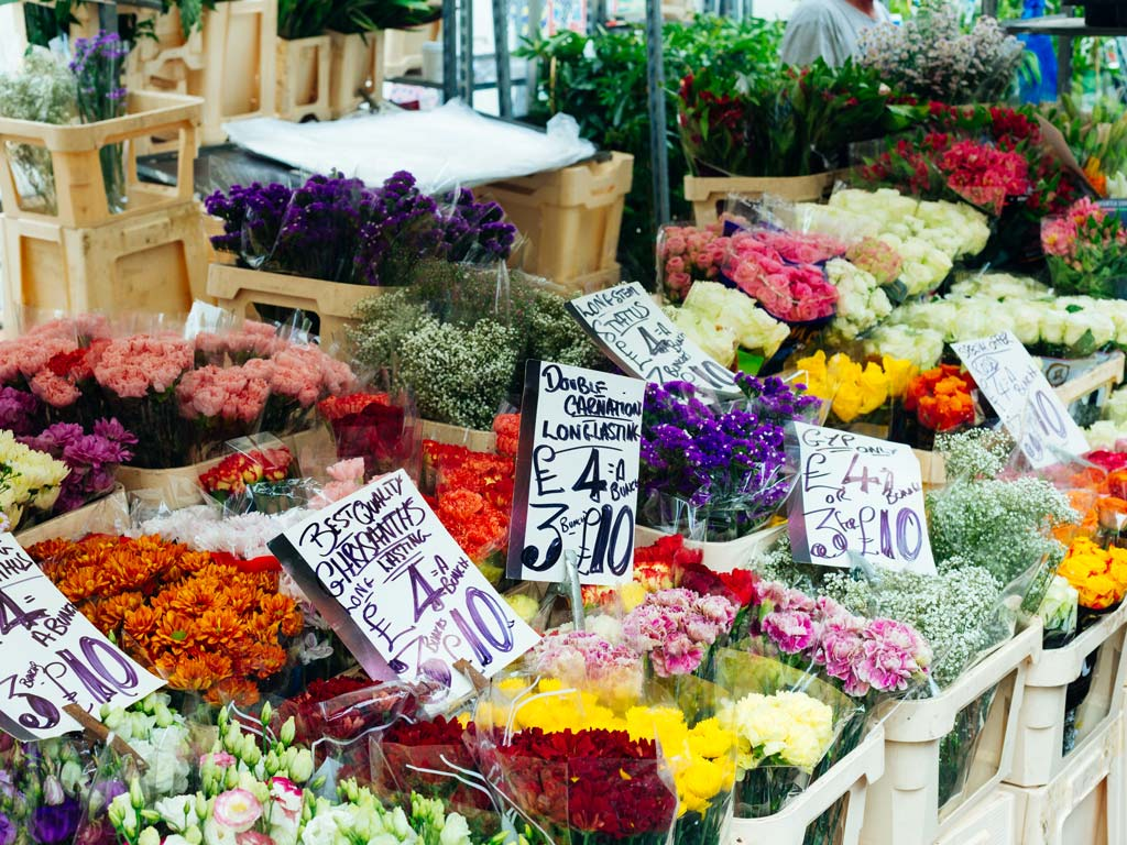 Displays of flower bouquets at Columbia Road Flower Market.
