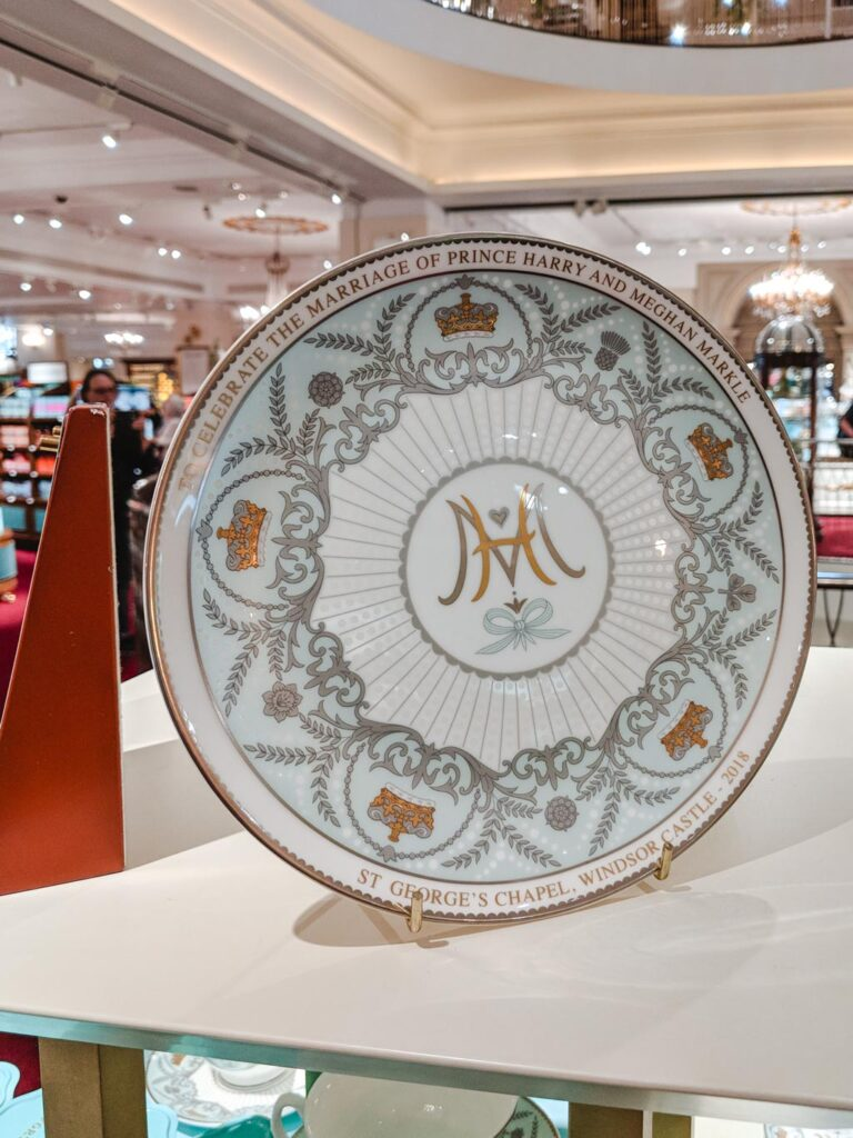 Blue and white tea saucer commemorating marriage of Prince Harry and Meghan Markle in Fortnum and Mason.