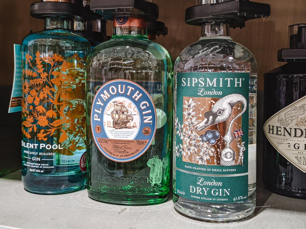 Three bottles of English gin: Sipsmith, Plymouth, and Silent Pool.