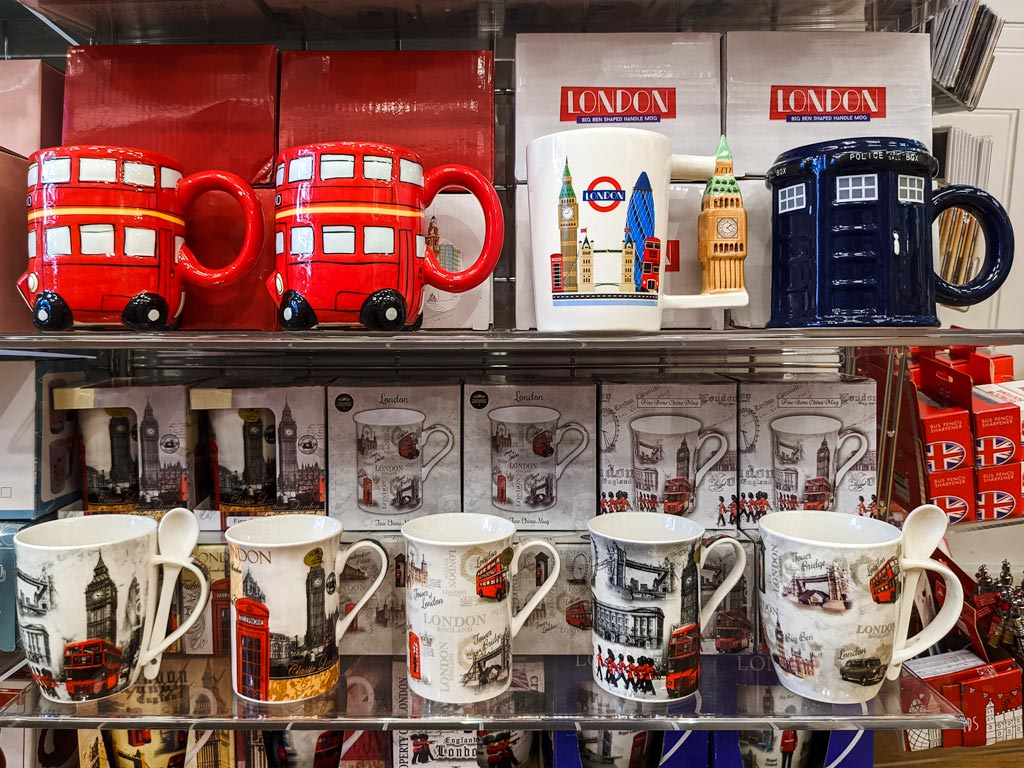 Shelves with London themed mugs including red bus and phone box.