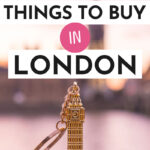 """Gold Big Ben keychain sititng on ledge by river, with text overlay - """"31 best things to buy in London""""."""