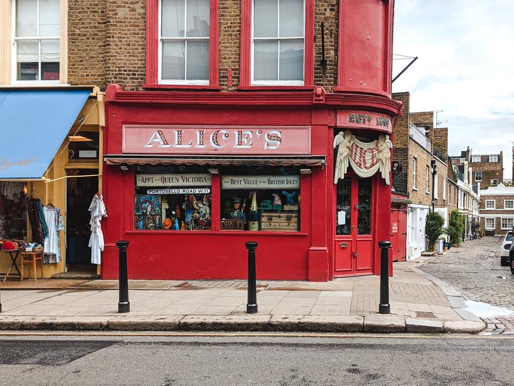 Red exterior of Alice's antique shop and Portobello Road market.