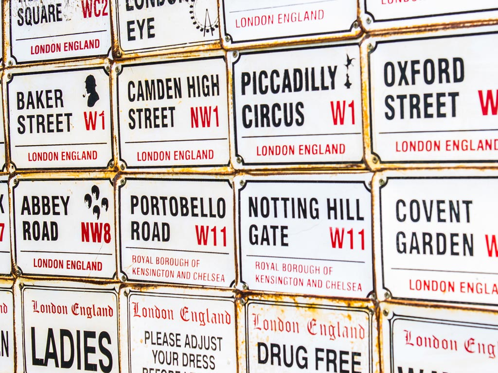 Rows of London street sign on display for sale.