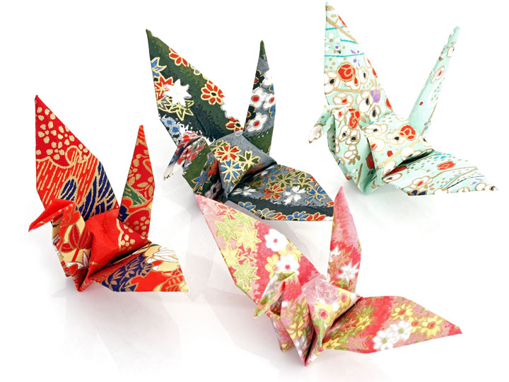 Red, white, and green origami paper cranes