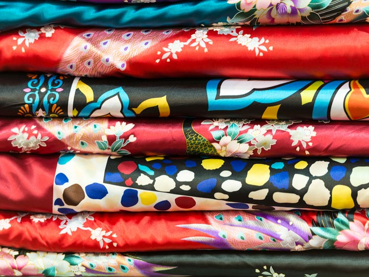 Layers of colorful silk fabric with various prints