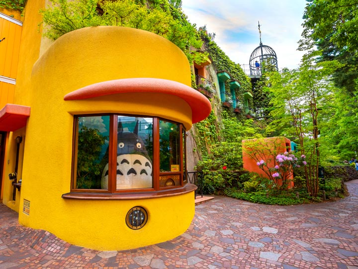 Entrance to Studio Ghiblu Museum with yellow ticket counter and Totoro inside
