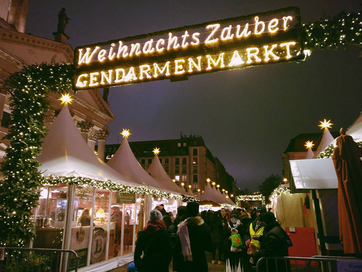 Berlin Christmas Market entrance illuminated at night, among the best European cities to visit in December