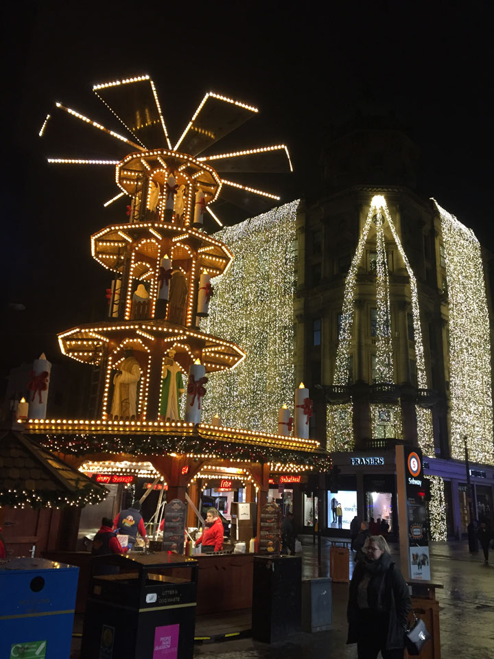 Illuminated ride and shopfront in Glasgow at Christmas