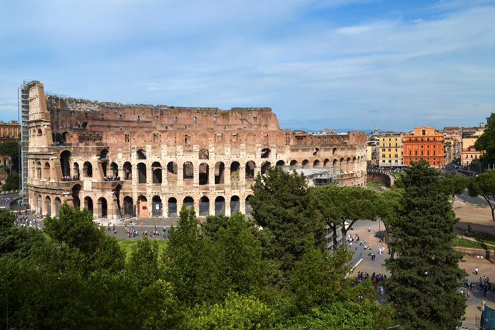 Exterior view of Roman Coliseum on partly cloudy day