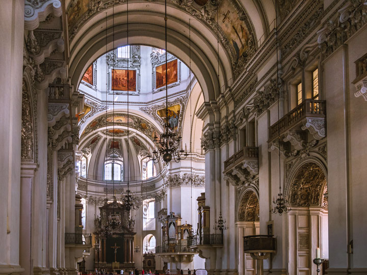 Interior of Salzburg Cathedral with arched vestibule and stained glass