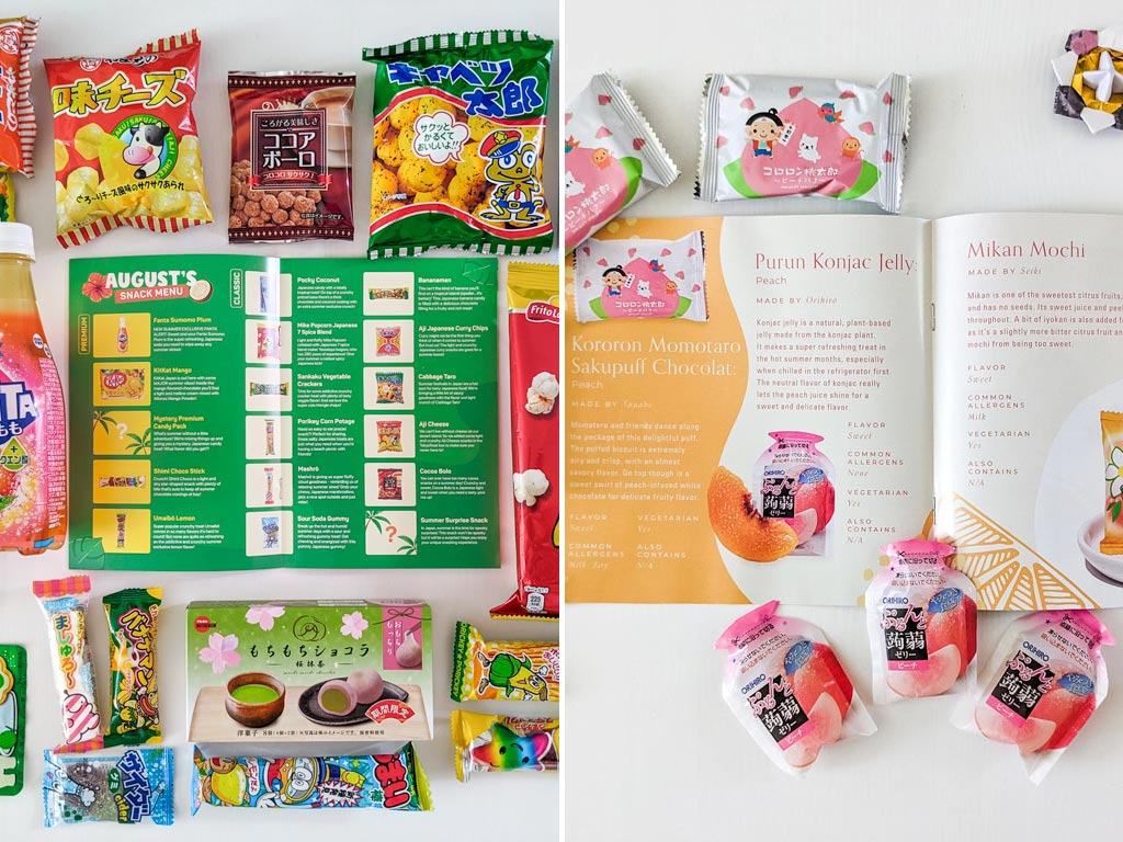 Flat lay of TokyoTreat vs Bokksu snack guides with various snacks surrounding open pages.
