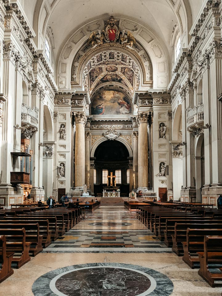 White marble interior and nave of Bologna Metropolitan Cathedral