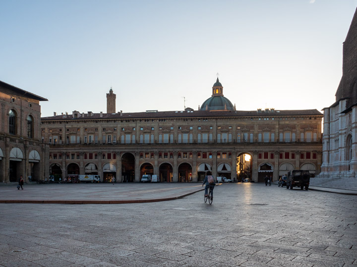Bologna Sightseeing at the Piazza Maggiore at sunrise with one cyclist