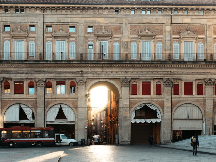 Stone facade outside the Quadrilatero entrance of Piazza Maggiore in Bologna