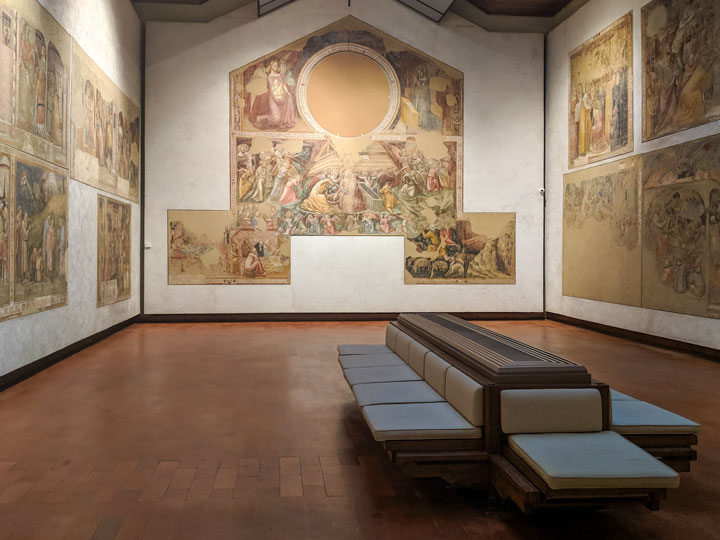Roman fresco room inside Pinacoteca Nazionale, one of the top places to visit in Bologna