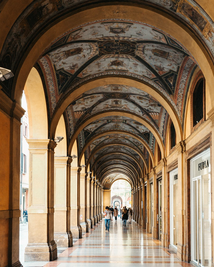 Blue and gold painted portico in Bologna city center