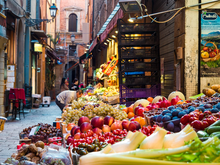 Fresh produce stand at the Quadrilatero, one of the most popular Bologna sightseeing attractions