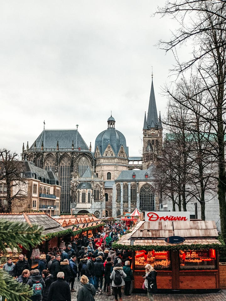 View of Aachen Christmas market stalls with cathedral in background