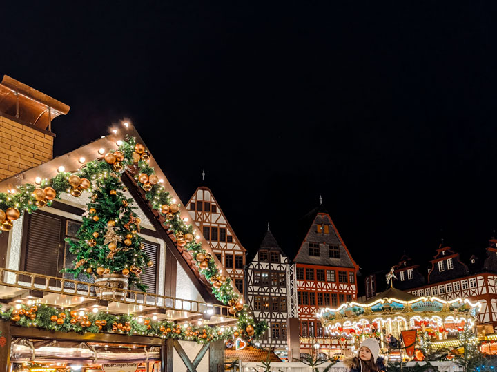 Frankfurt German Christmas Market at night with chalet and carousel