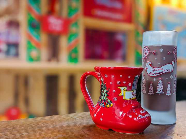 Red boot and tall frosted mugs at Munich Christmas market