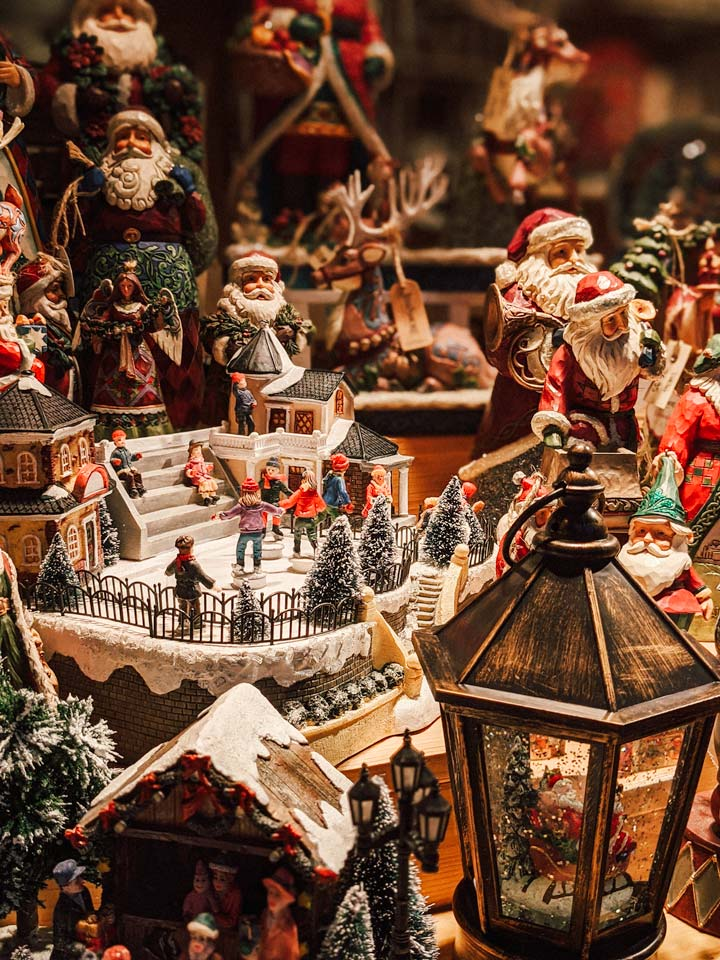 Snow globes and Santa decorations for sale during this Germany Christmas market itinerary