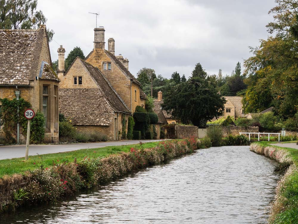 Cotswolds village houses on canal--living here drives up the cost of moving to the UK
