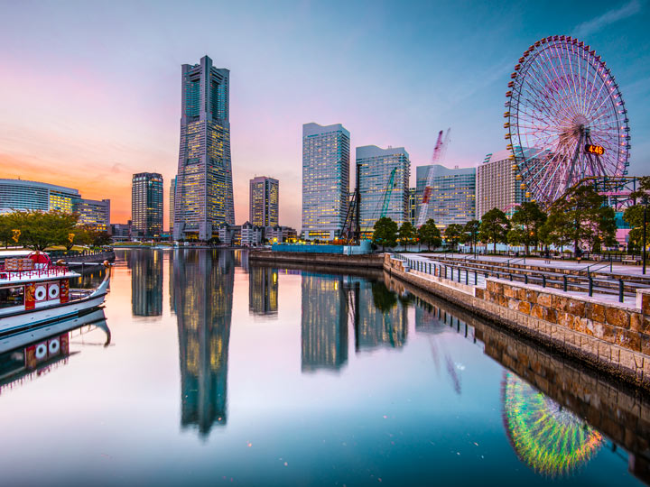 Yokohama Minato Mirai district with skyscrapers and ferris wheel reflected in water